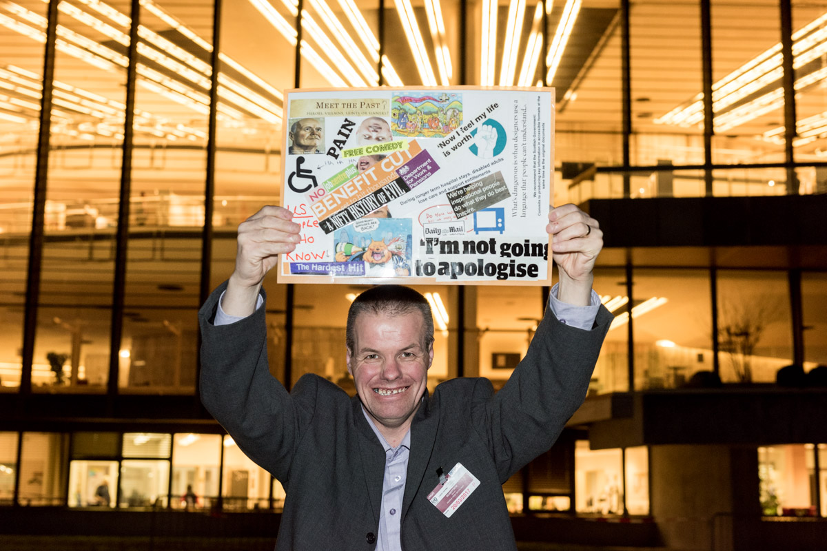 Steve Robertson (People First Scotland) championing his own personal artwork/cut-up at the United Nations in Geneva. (Photo: Natasha Hirst, Disability Wales - @HirstPhotos)